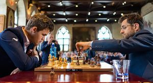 Levon Aronian starting his game with Magnus Carlsen in round one