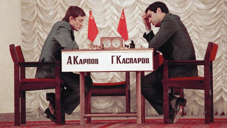 Anatoly Karpov, left, defending world chess champion, and challenger Garry Kasparov, both of the Soviet Union, compete in September 1984 in the World Chess finals in Moscow