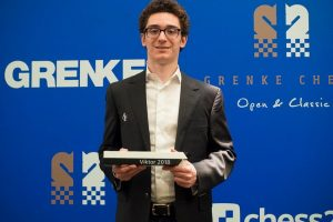 fabiano-caruana-with-grenke-trophy